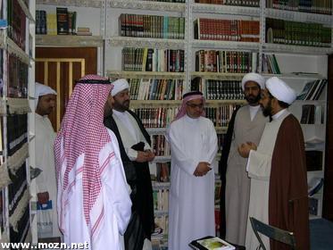 في مكتبة سماحته بمنزله المتواضع